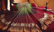 Torchon bobbin lace on a roller pillow